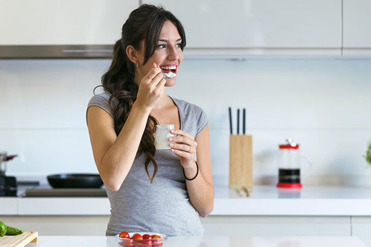 woman-eating-fermented-foods-for-healthy-skin