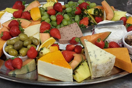 variety of cheeses with probiotics on a tray
