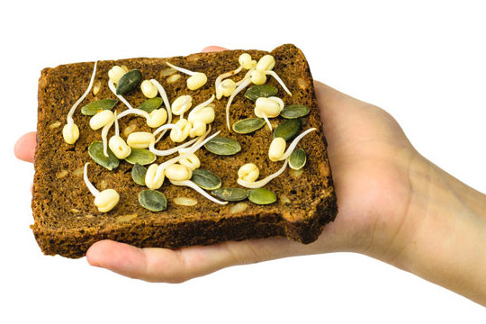 sprouted pumpkin seeds on bread